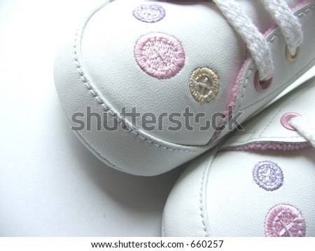 Baby shoes with buttons embroidered - stock photo