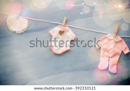 Baby Shower Clothing line - lens flare - stock photo