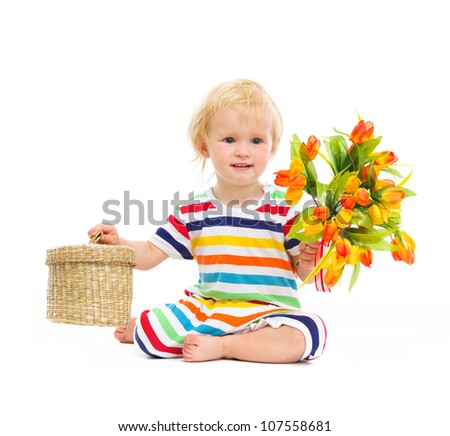 Baby sitting and presenting flowers and box
