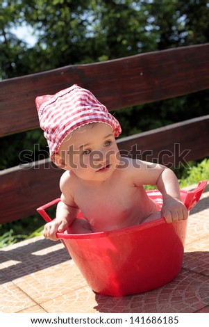 Baby sitting in a bowl - stock photo