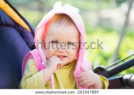 baby sitting in a wheelchair - stock photo