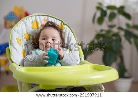 Baby sitting baby chair played toy stock photo 251507911 for Toddler sitting chair