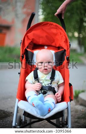 Baby sitting in stroller #5 - stock photo