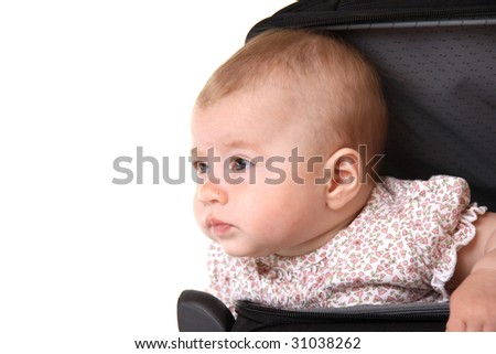 Baby sitting in suitcase - stock photo