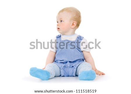baby sitting looking in the direction isolated on white background