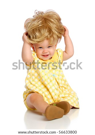 Baby Sitting Trying Wig - stock photo