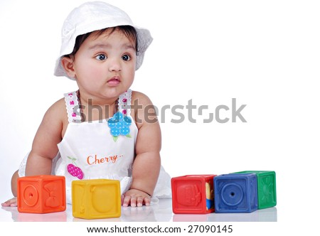 baby sitting with colorful blocks - stock photo