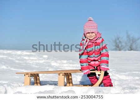 baby sledding - stock photo