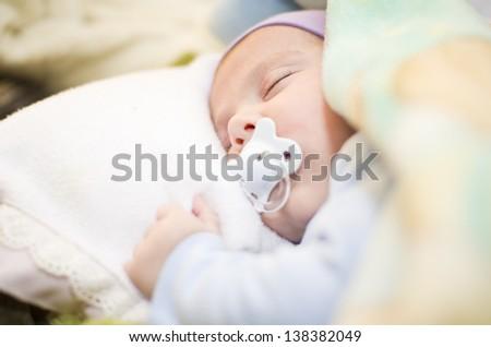 Baby sleep between sheets - stock photo
