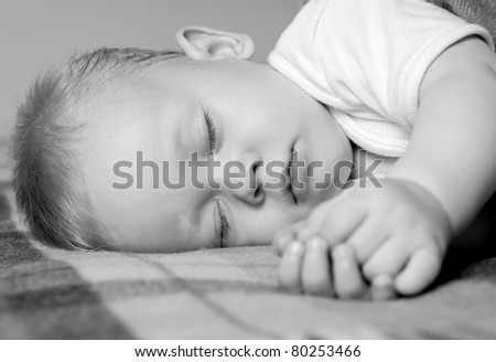 baby sleep under a blanket
