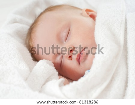 baby sleep under a white blanket - stock photo