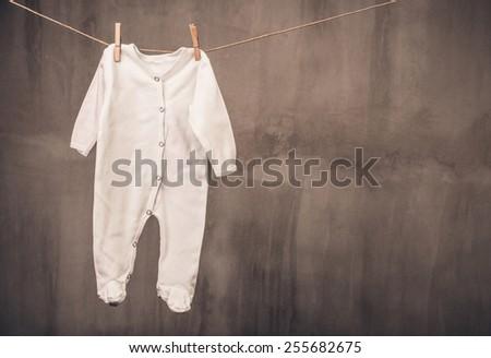 Baby sleeper on the clothesline - stock photo
