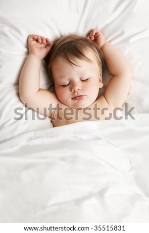 Baby sleeping in bed - stock photo