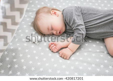 Baby sleeping in bed