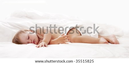 Baby sleeping in bed looking beautiful - stock photo