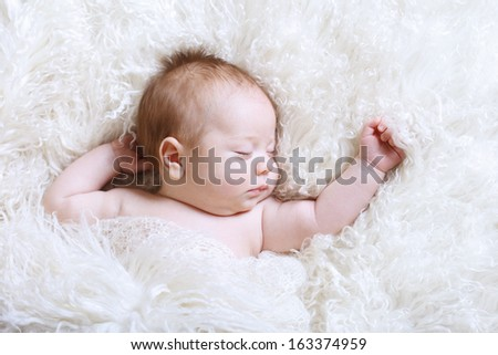 baby sleeping in soft fur bed... - stock photo