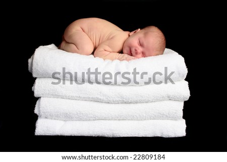 Baby Sleeping on Towels - stock photo