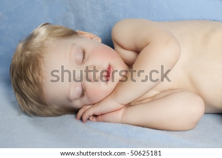 Baby Sleeping with Blue Background - stock photo