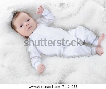 baby sleeps with a pacifier in her mouth - stock photo