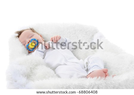 baby sleeps with a pacifier in her mouth. Isolated on white background - stock photo