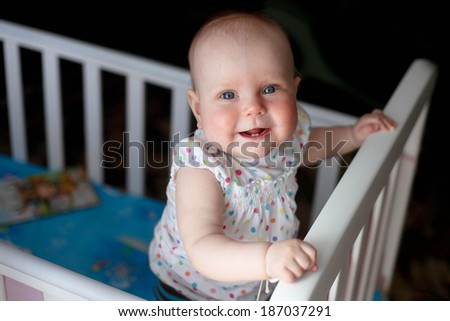 Baby  smiling and showing his first teeth. - stock photo
