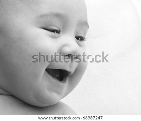 baby smiling, black and white photo closeup - stock photo