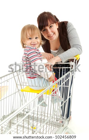 baby son in trolley with mother taking shopping, white background - stock photo