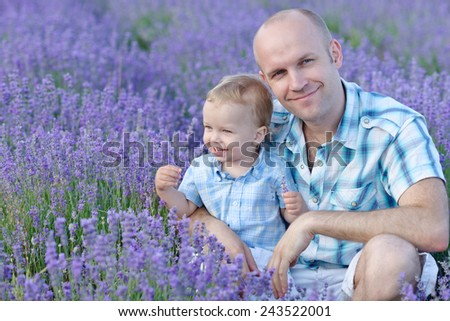 baby son with dad in lavender field - stock photo