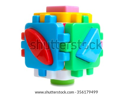 Baby sorter with geometric figures from plastic on a white isolated background