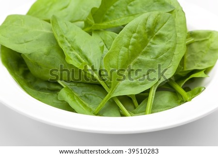 Baby spinach leaves in a white bowl