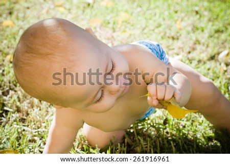 Baby sunbathing in the garden