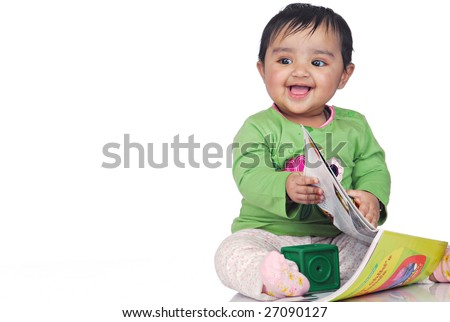 baby surfing magazine pages - stock photo