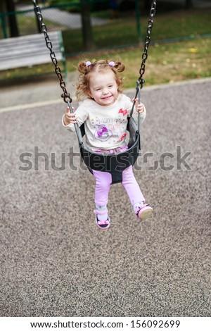 Baby swing. - stock photo