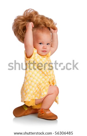 Baby trying on a wig - stock photo