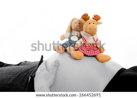 baby tummy in black and white with stuffed animals - stock photo