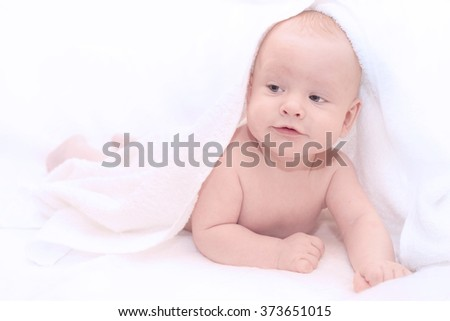 Baby under white towel