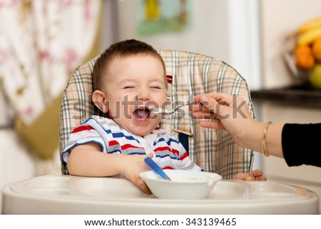 Baby unwilling for feeding. - stock photo