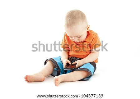 baby using a mobile phone - stock photo