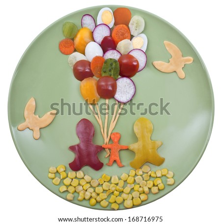 """Baby vegetable dish """"Happy family with balloons"""" - stock photo"""