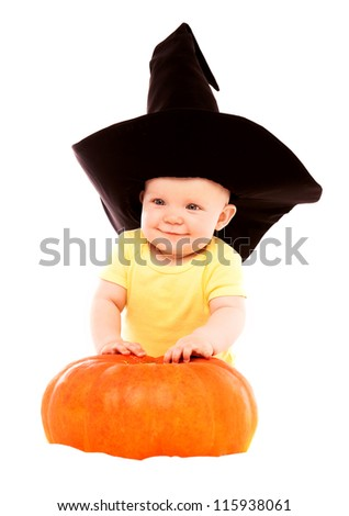 baby wearing a witch's hat with a big  pumpkin, isolated on white - stock photo