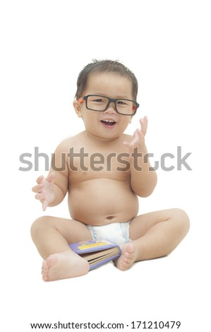 baby wearing eyeglasses with a book white isolated. - stock photo