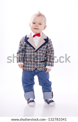 Baby wearing suit on white background - stock photo