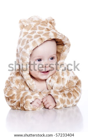 baby wearing tiger suit sitting isolated on white - stock photo