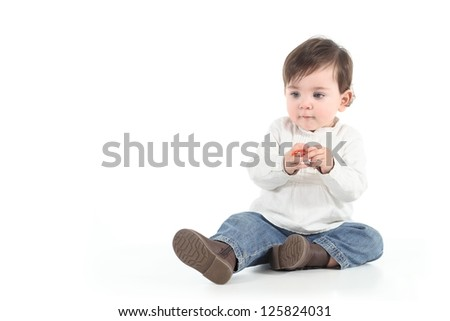 Baby with a candy in her hands on a white isolated background