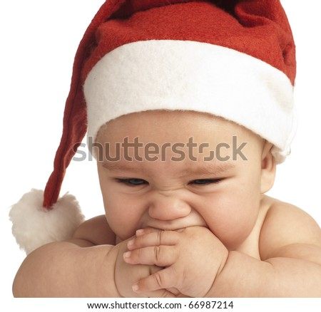 baby with a christmas hat on white background - stock photo