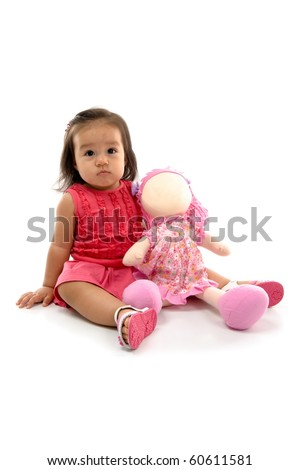 Baby with a doll on white background .