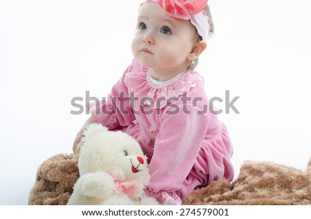 baby with a soft toy in the plaid - stock photo