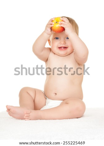 baby with apple on white - stock photo