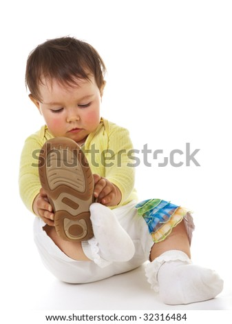 Baby with big boots - stock photo