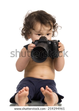 Baby with camera, isolated on a white background. - stock photo